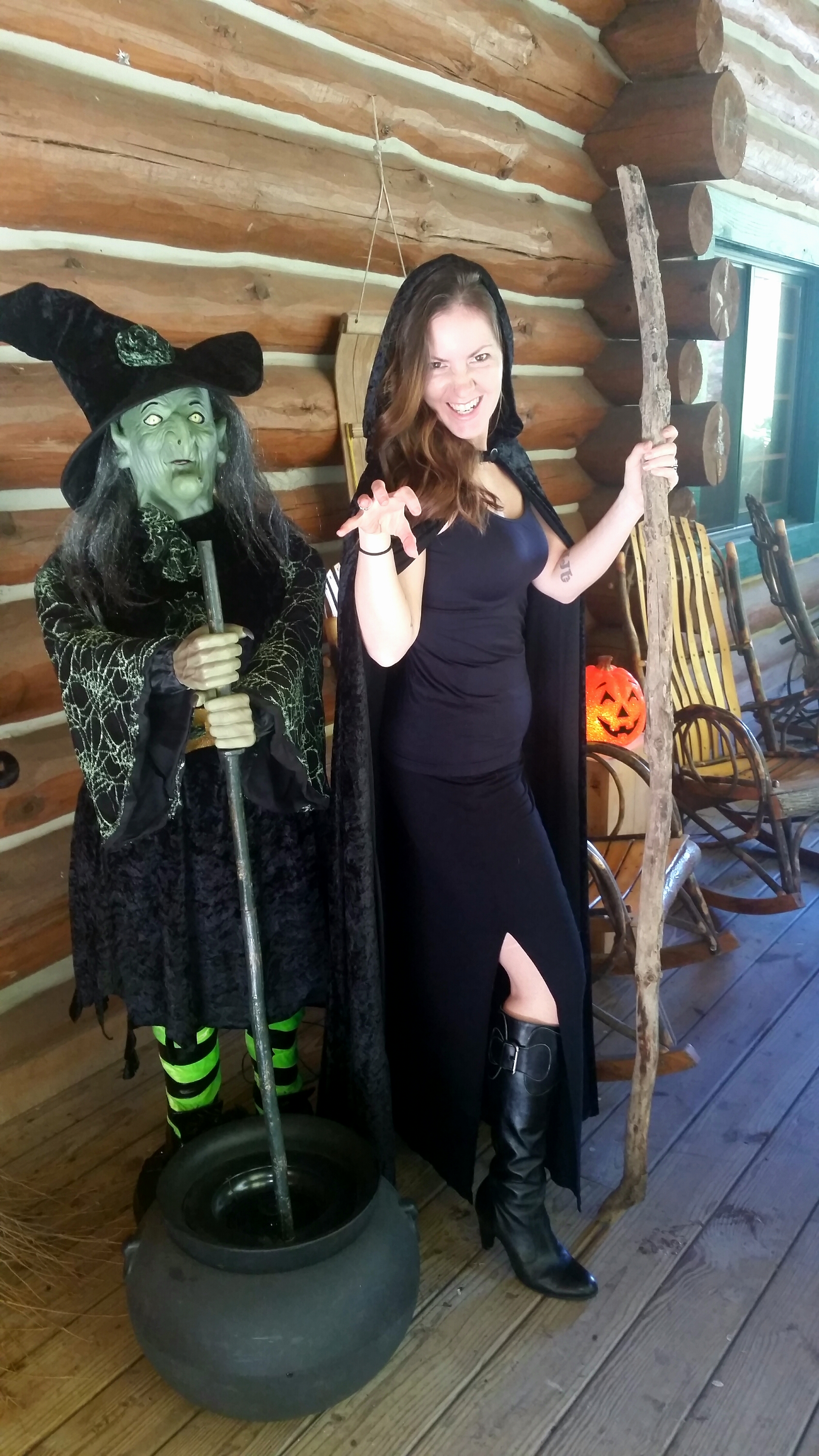 girl posing next to witch