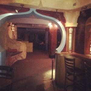Archway and seating inside restaurant