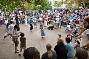 Dancing people in center of drum circle