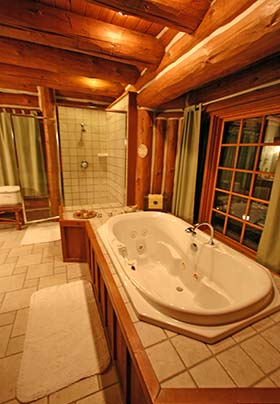 Large jetted soaking tub and stand alone shower with tile floors and wood trim through out
