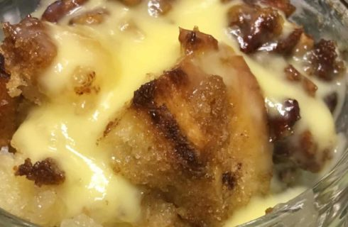 Glass parfaith dish full of creamy bread pudding