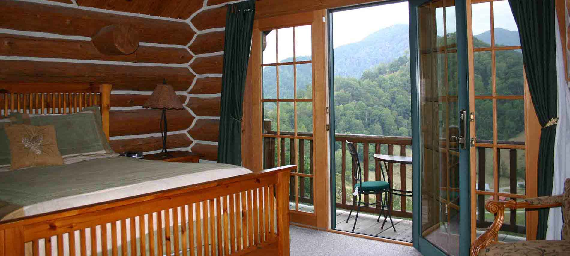 Gooseberry guest room with log walls, balcony and stunning mountain views