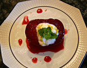 White plate topped with wine poached juicy plums