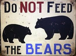 do not feed bears sign