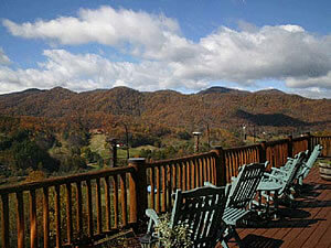 Rocking Chairs on deck with Mountain views, Blue Skies with large white fluffy clouds