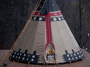 Teepee with Blue design with white circles and Red coming down the front and around the top
