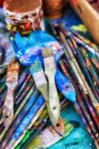 colorful paint and paintbrushes