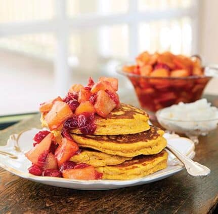Pumpkin pancakes topped with cranberry apple compote