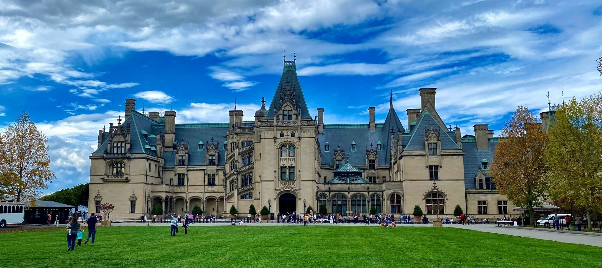 Exterior view of the stunning Biltmore Mansion in Asheville on a clear sunny day