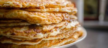 Stack of freshly made golden brown pancakes