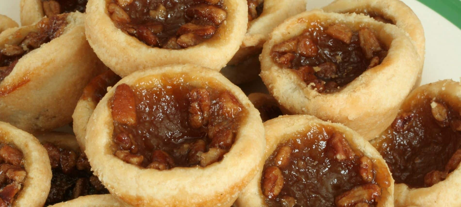 Plate full of freshly bakes pecan tarts